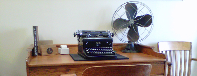 desk with typewriter and fan