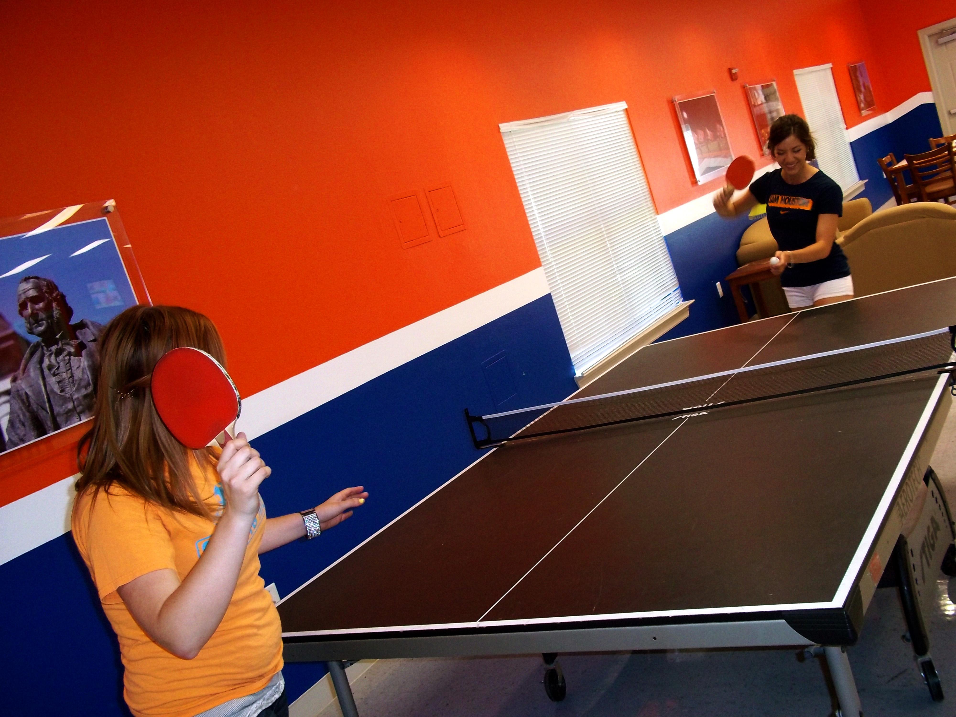 Girls playing ping pong