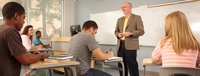 Professor standing in front of a class teaching