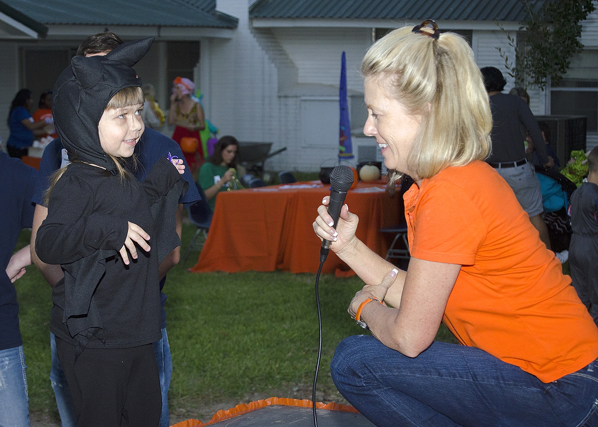 President Hoyt talking to child dressed as a bat
