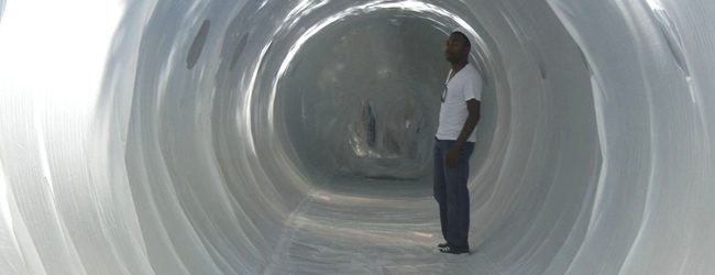 student standing in an inflatable tunnel