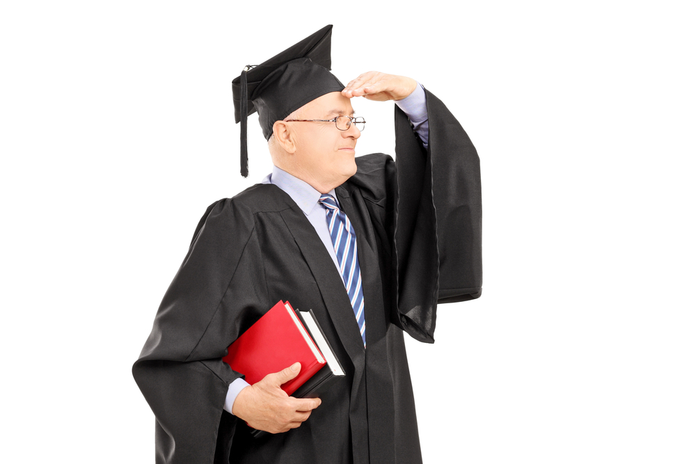 Photo of a doctoral candidate in graduation robe looking ahead