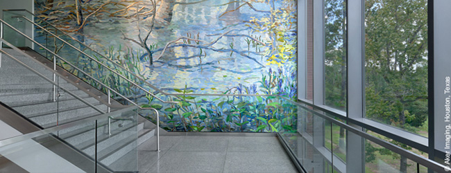 Stairwell with windows and artwork on wall