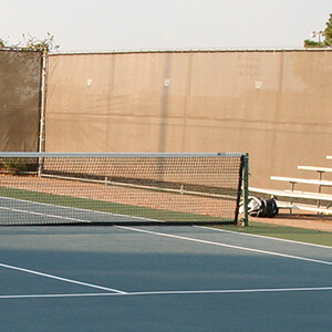 half net and bleachers of tennis court