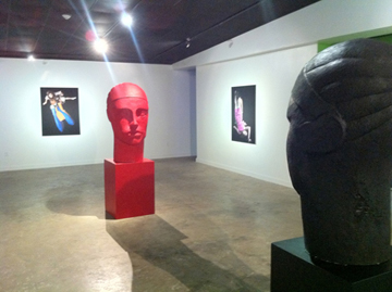Red bust of a woman in a gallery