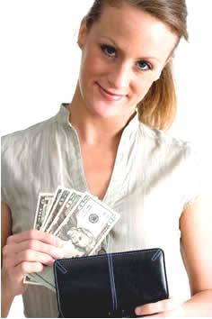 Woman smiling and pulling money from wallet.