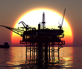 Ocean oil rig at sunset