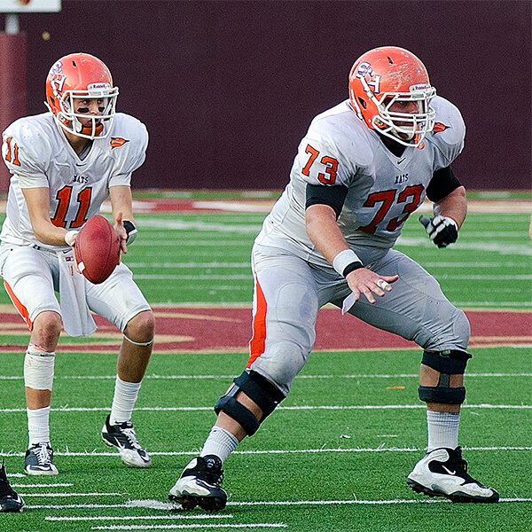 Travis Watson protecting the quarterback as center for the Bearkats in 2011.
