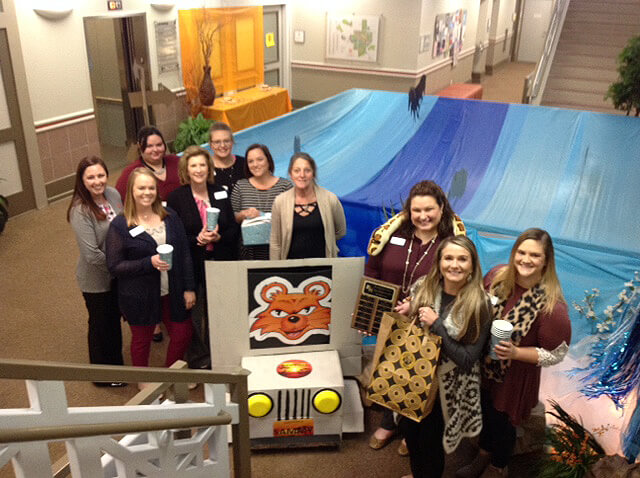 Financial Aid/Scholarship Office group photo with decorations
