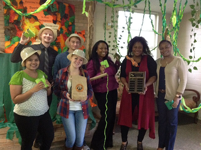 Equity & Inclusion Title IX and Student Money Management Center group photo with decorations