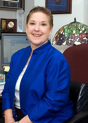 Caroline Castillo sitting at her desk