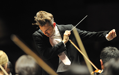 Justin Brown conducting a performance