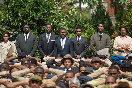 movie still a large group of African American's most of them standing with their hands behind their heads