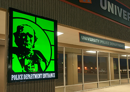 close up of the green sign on the front of the UPD building