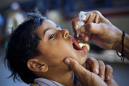 child receiving the polio vaccine