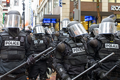 group of police officers wearing riot gear