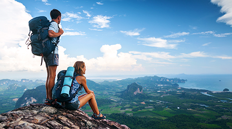 man and woman on mountain looking out to land