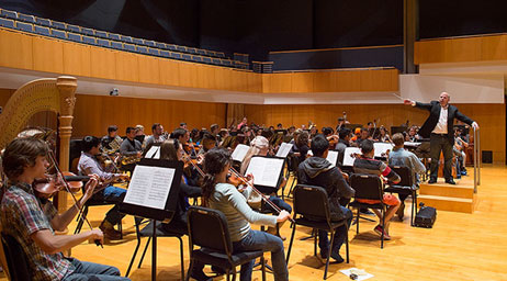 A group of students are playing in an orchestra.