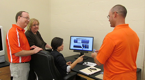 faculty helping student with computer program
