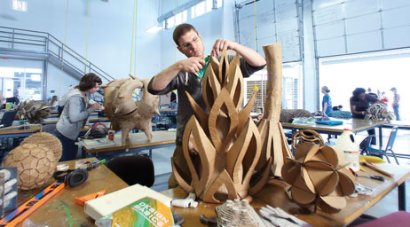 Students are crafting sculptures in an art studio.