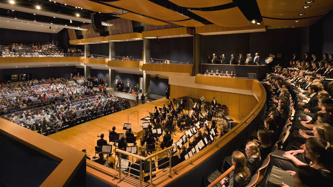 The SHSU concert hall with an orchestra in concert and attendees in the hall
