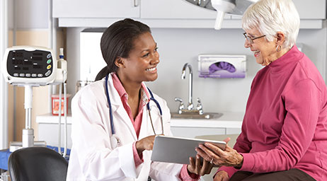 A healthcare worker talking with a patient.