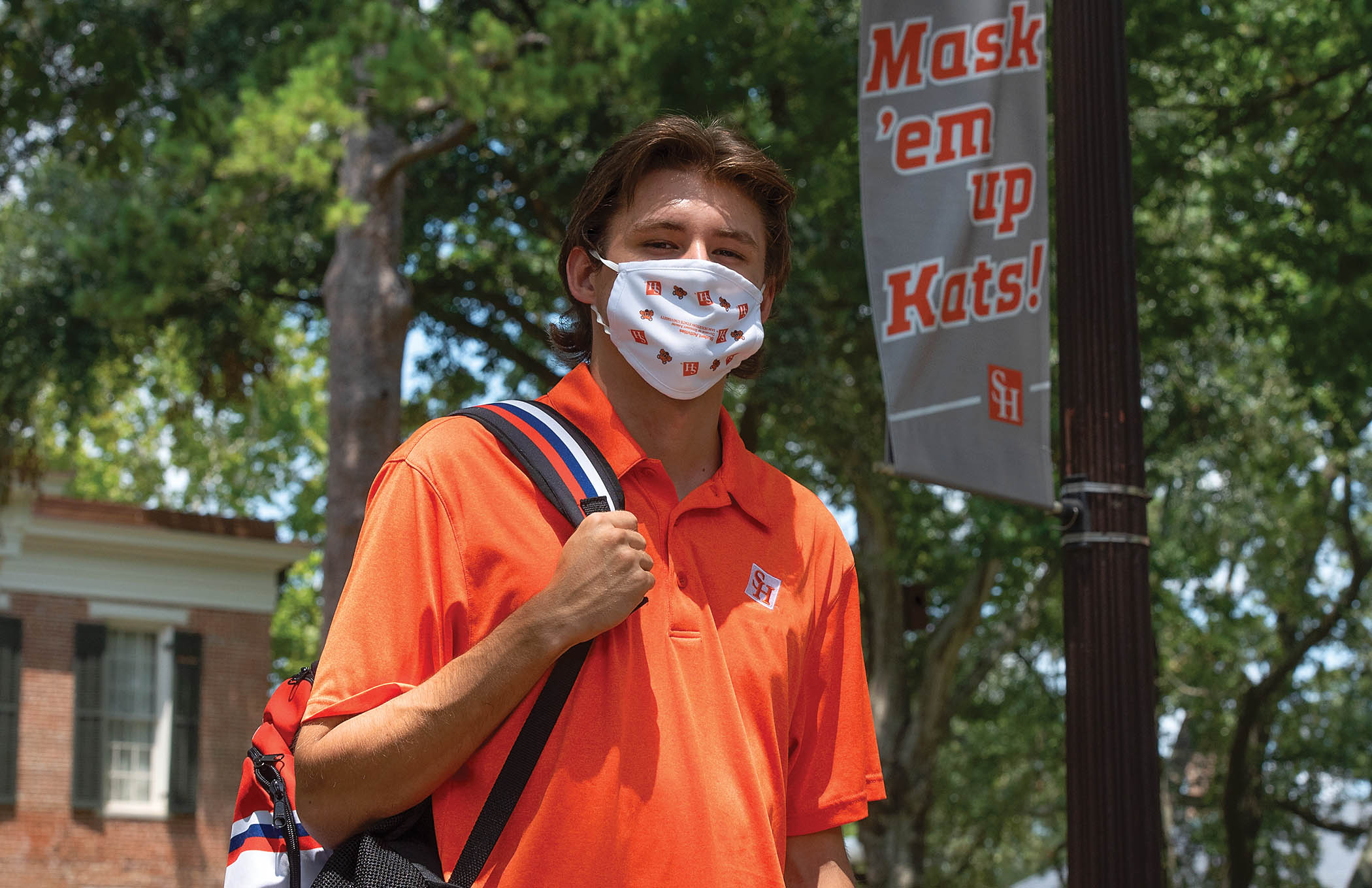 Student on campus wearing a mask