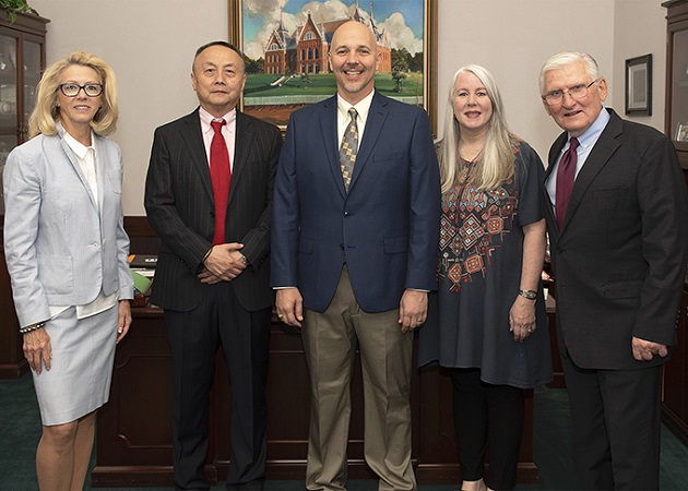 """President Dana Hoyt (far left) and Provost Richard Eglsaer (far right) recently recognized the 2018 Faculty Excellence Award recipients. They are (from left) Jihong """"Solomon"""" Zhao, Ronald Daigle, Edie Wells and Bala Maniam (not pictured)."""